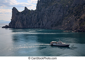 Ship in fanciful bay - Excursion tourist ship on fanciful...
