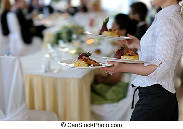Waitress carrying three plates - Waitress is carrying three...