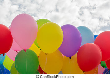 A colorful flying balloon in blue sky