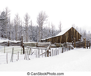 Rustic Snowy Barn - A rustic barn and fencing following a...