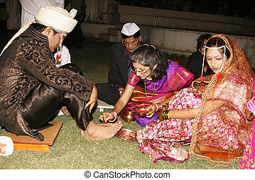 Indian Wedding Ceremony - An Indian family in a traditional...