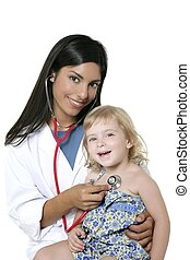 Brunette pediatric doctor with blond little girl on medical...