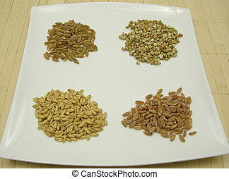 Four different grains on a white plate