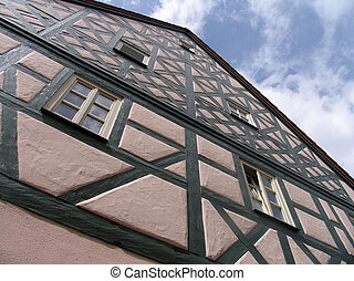 half-timbered facade of the house on the street of the old...
