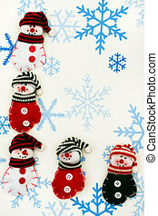 Happy Holidays - Snowman mittens sitting together on a...