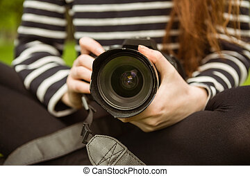 Mid section of female photographer - Close up mid section of...
