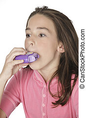 Caucasian Child - Cute Caucasian girl using an inhaler for...