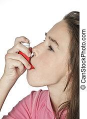 Caucasian Child - Cute Caucasian girl using an inhaler for...