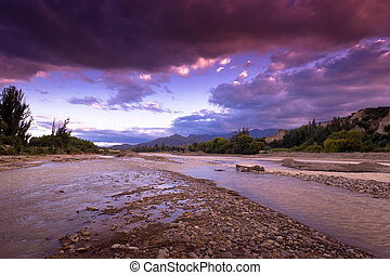 River in Bolivia - The mountain river in Bolivia against the...