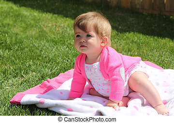 Adorable little girl outdoors in Summer