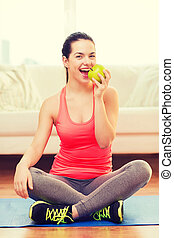 smiling teenage girl with green apple at home - healt,...