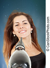Beautiful woman drying her hair with hairdryer - Beautiful...