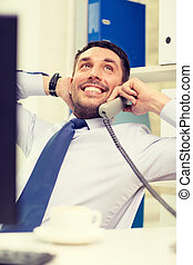 smiling businessman or student with computer - office,...