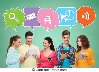 happy friends with smartphones and tablet pc - people,...