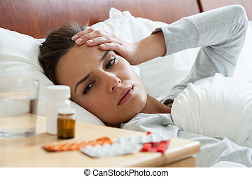 Ill woman feeling headache - Horizontal view of ill woman...