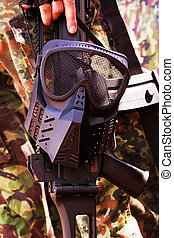 Mask - Face of war - Black war mask hanging on a rifle