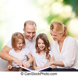 happy family with book at home - family, childhood, ecology...