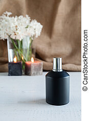 Perfume bottle with flowers on wooden board