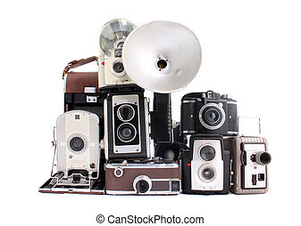 Antique cameras - Old antique cameras in a pile on a white...