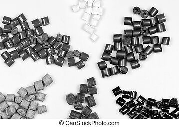black, grey, and white plastic polymer pellets on white