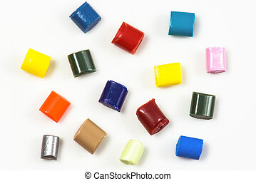 fifteen different dyed plastic granulates