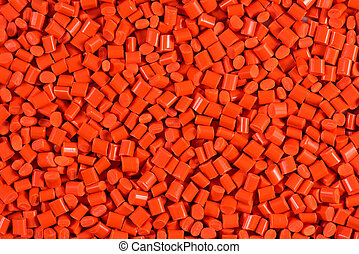 orange dyed plastic granulate