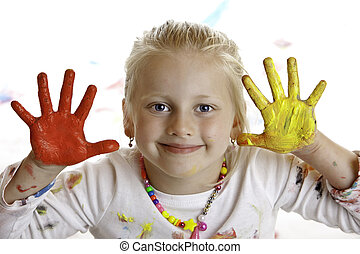 Closeup of a smiling child with painted hands