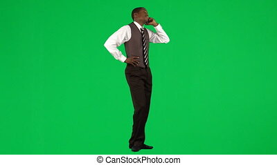 Young businessman calling by phone - Young ethnic...