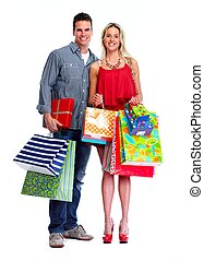 Loving couple with shopping bags - Loving couple with...