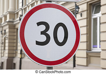 Thirty Kilometer Per Hour Speed Limit Sign in Urban Setting