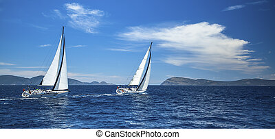 Panorama of the yacht race in the open sea. Sailing. Luxury...
