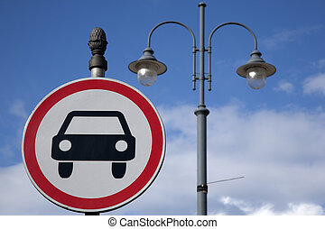 Car Sign and Lamppost against Blue Sky Background