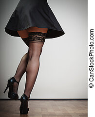 Sexy female legs in dance. Girl in black dress stockings and...