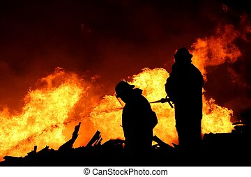 Firemen Silhouette - Silhouette of two firemen fighting a...
