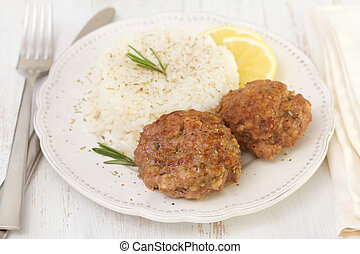 meatballs with boiled rice and lemon