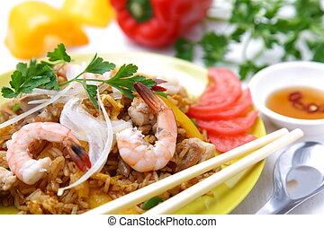 nasi goreng - studio shot of Indonesian fried rice called...