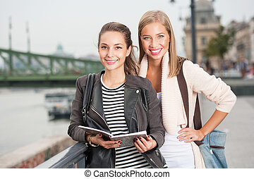 Student friends. - Portrait of two gorgeous young student...
