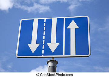 Blue and White Triple Arrow Sign against Blue Sky Background