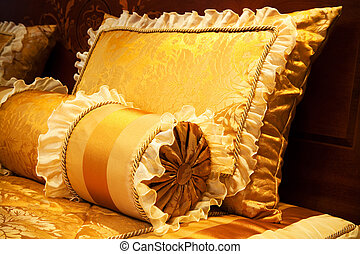 yellow pillows - beautiful yellow pillows on the beds of...