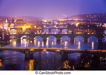 Vltava Moldau River at Prague with Charles Bridge at dusk,...