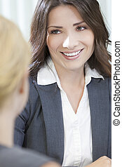 Two Women or Businesswomen in Office Meeting - Two young...
