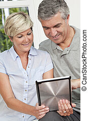 Happy Man & Woman Couple Using Tablet Computer