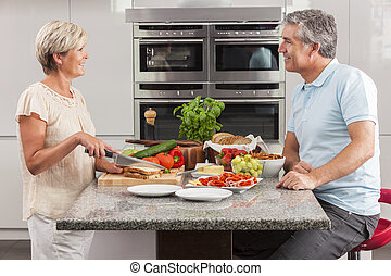 Man Woman Couple Making Sandwiches in Kitchen - Man woman...