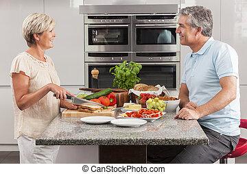 Man Woman Couple Making Sandwiches in Kitchen - Man & woman...