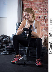 Woman preparing to crossfit training - Blonde fit woman...