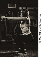 Exercise With Kettle Bell - Young Woman Working Out With...