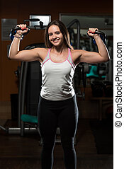 Woman And Kettle Bell - Young Woman Working Out With Kettle...