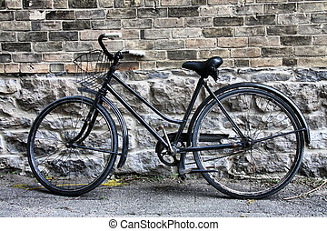 Old Bicycle - Old bicycle set and left idle in alley way