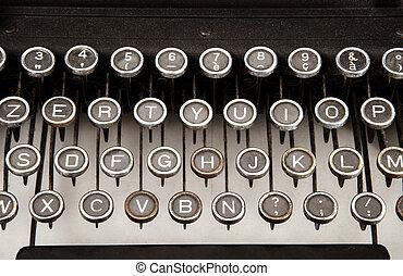 old typewriter - particular of old typewriter on white...