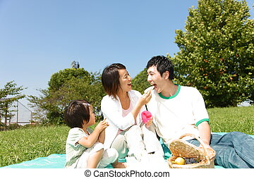 familiy of three enjoy Picnic - portrait of Japanese familiy...